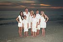 Family on JW Marriott beach at sunset
