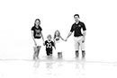 Black and white family in Marco surf
