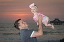 Sunset father and baby daughter on Marco Island