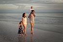 family walking on Marco Island beach