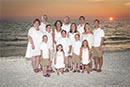 large family on beach at sunset
