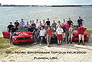 group photo with cars