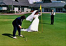 bride and groom golfing