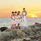 bridesmaids and bride sunset